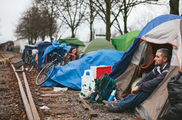 Bands of tents set down in a wooded area flashes of blue tarp dangling from a freeway overpass or clusters of cardboard wrestled into shapes that ...  sc 1 st  Seattle Magazine & Tent Cities and Seattleu0027s Growing Homeless Population | Seattle ...