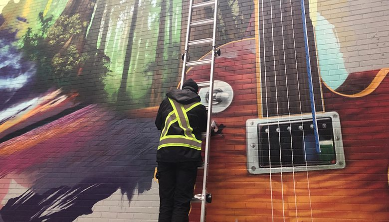 Jeff Jacobson working on the mural at The Sound Hotel Seattle Belltown