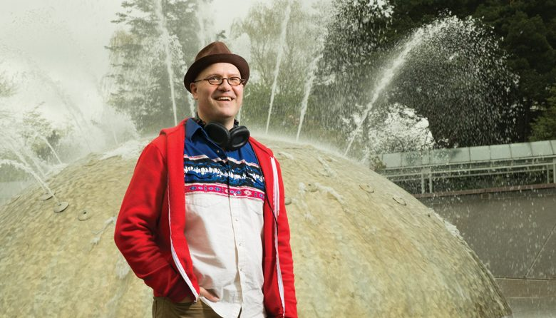 James Whetzel, in front of the International Fountain at the Seattle Center; he's responsible for the fountain's playlist