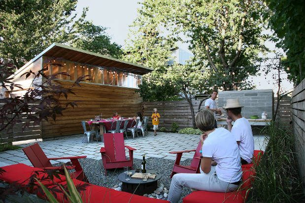 with a pizza oven this backyard became a social gathering space