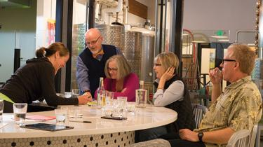 """Kim Karrick (left) teaches her """"Giniology"""" class at Scratch Distillery in Edmonds. Botanical distillates allow you to customize your own gin"""