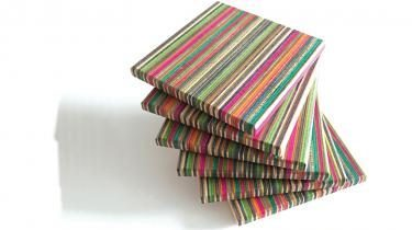 The rainbow of colors in Jared Bolt's coasters come from layers of skateboard decks