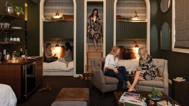 The plush bunk room at the Atticus Hotel features cozy sleeping cubbies